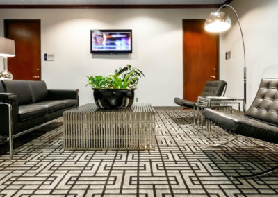 Seating areas and waiting areas with televisions.